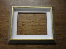 these two canvas tray frames or float frames have been gilded in metal leaf with distressed paint on the inside and outside finished off with light paint