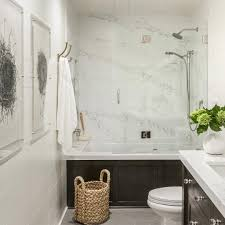 bathroom remodel gray. White Quartz With Dark Gray Veining Is The Showstopping Focal Point For  This Remodeled Hall Bathroom Remodel