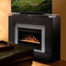 electric corner fireplace tv stand with espresso base glass riser shelf black leather square ottoman tray cinnamon brown wall paint stands