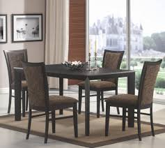 black table multi colored chairs dining set