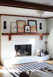 living room off center fireplace white painted brick fireplace
