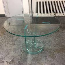 a modern glass dining table a round 48 inch glass sits on a four glass