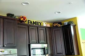 top of kitchen cabinet decor tips and ideas for storage decorating above cabinets on home solutions