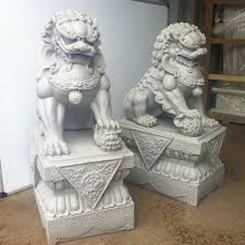 Fu Dog, used in front of official buildings for demon scaring. The lion is