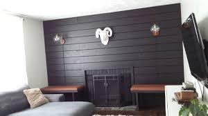 black shiplap fireplace wall