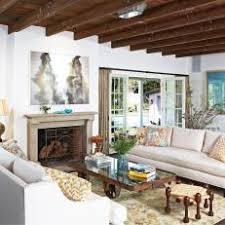White Living Room with Exposed-Beam Ceiling