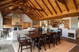 contemporary dining room with exposed beam color bound seagrass rug pottery barn banks