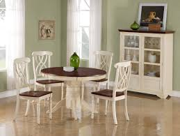 white dining table set. Dining Room : A Simple Antique Table Sets In Minimalist With Round Wooden Table, White Chairs And Cabinet, Painting, Vas, Set G