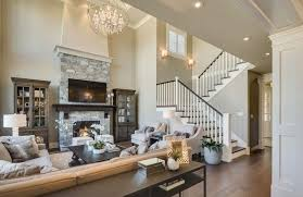 this luxurious living room has a large authentic stone fireplace the television fits nicely above