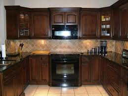 maple kitchen cabinets with black appliances. Maple Wooden Cabinet And White Floor Tiles For Traditional Kitchen Ideas With Perfect Black Appliances Cabinets