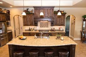 dark cabinets light granite backsplash fresh kitchen with an
