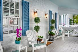 the porch of cottage 1 at the gardens hotel in key west florida