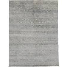 transitional grass cloth patterned gray area rug with modern style for