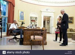 obama oval office. U.S President Barack Obama Talks On The Phone From Oval Office With Secretary Of State John Kerry Regarding Coup Attempt In Turkey As Chief Staff N