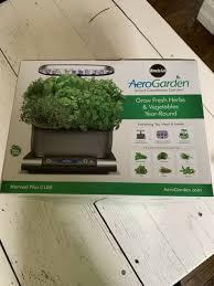 miracle gro aerogarden harvest plus smart countertop garden in grey
