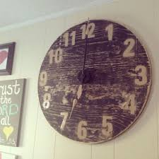 cut wood circle clock kit from hobby lobby paint black then sand til wood shows stencil or hand paint numbers