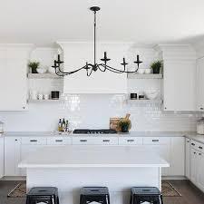 light gray floating shelves with white shiplap range hood