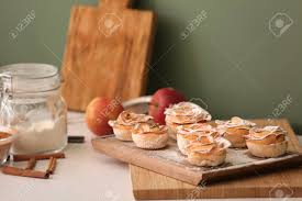 Tasty Apple Roses From Puff Pastry On Kitchen Table Stock Photo