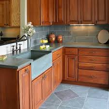 green slate countertops with integrated slate sink slate tile backsplash and floor tile