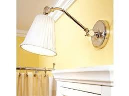 friendly bathroom makeovers ideas:  use extended light fixtures over medicine cabinets
