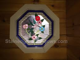 stained glass hummingbird flowers octagon panel set against their existing window and held in place with 3 small nails