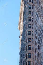 Professional Window Cleaner At Flatiron Building In New York Stock