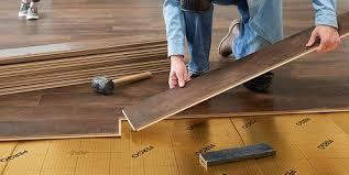 Pictures of laminate flooring Hardwood Flooring Man Installing Dark Brown Laminate Flooring Over Gold Underlayment Lowes Laminate Flooring Accessories