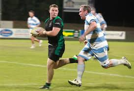 u s department of > photos > photo essays > essay view a darwin rugby team player runs the ball down the field during the first 9