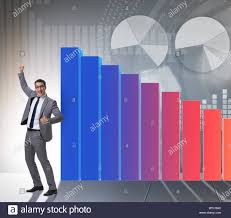 Young Businessman In Business Concept With Bar Charts Stock