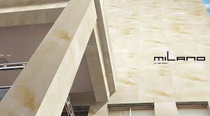 milano sandstone effect thin porcelain tiles have been used to clad the exterior walls of this