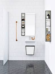 square white tiles and black hexagon tiles contrast in the shape and color