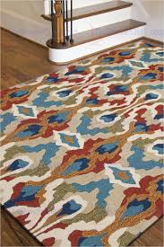 jaipur brio chapan hand tufted tribal pattern polyester blue red area rug
