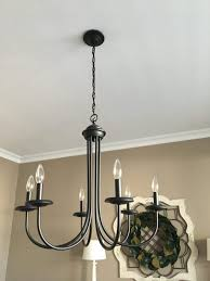 the portfolio 6 light black linear chandelier was a perfect fit unfortunately it is no longer available at but here is a similar one from
