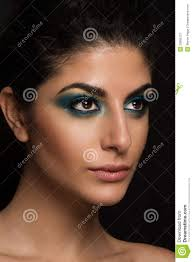 beautiful closeup portrait of young caucasian female isolated white background blue eye makeup