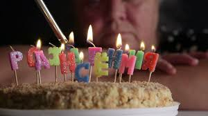 sad senior woman looking at birthday cake with lighting candles happy birthday in russian stock footage blocks