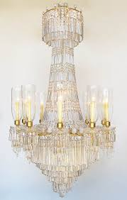 19th 20th century gilt bronze and baccarat crystal eighteen light cascade style chandelier the elongated frame with long rectangular cut glass drops in