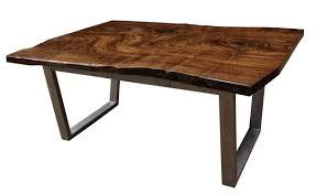 a claro walnut slab desk with a secret compartment