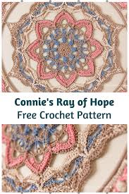 The wall hanging's main part is worked in rows: Amazing Crochet Mandala Wall Hanging Free Pattern