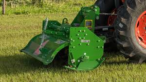 field image of a frontier rt12 series rotary tiller on the back of a tractor