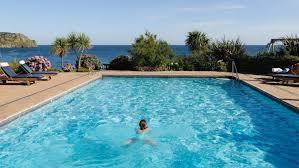 swimming pool. Someone Swims In The Nare\u0027s Outdoor Pool. Swimming Pool