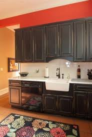 Distressed Kitchen Furniture Distressed Black Kitchen Cabinets With Farmhouse Sink And Antique
