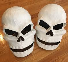 Twin paper mache skull masks - base coat
