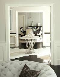 round black and white cowhide rug round center of foyer table with white cowhide rugs black