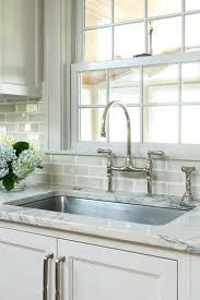 backsplash for kitchen cabinets designs revere pewter light gray kitchen cabinets ivory supreme counters bridge faucet and tiled kitchen backsplash ideas