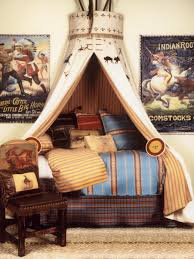 Stylish Wild West Indian Themed Kids Bed Canopy In A Bedroom Decorated With  Movie Posters And Pillows