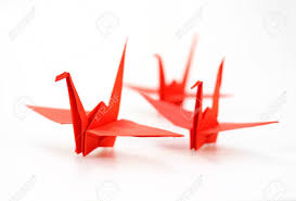 Traditional Japanese Origami Crane Made Of Red Paper Over White