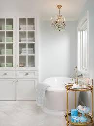 emerald green crystal chandelier over roll top bathtub