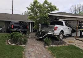 Two Pickup Trucks Damage Woodland Home after One Crashes Into the ...