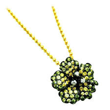 small flower pendant with yellow green sapphire and diamond for