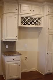 built in wine rack above fridgestill on the fence about this one but maybe cabinet fridge b37 above
